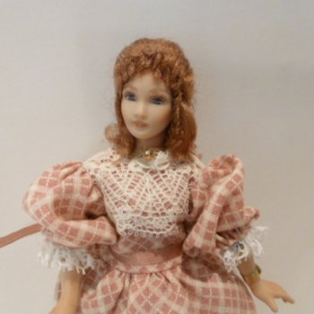 Lady Doll wearing pink/white checkered dress