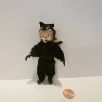 Doll wearing Halloween Cat costume by Cathy Ellis-O'Brien